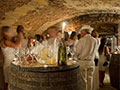 medieval cellars set for a wine tasting