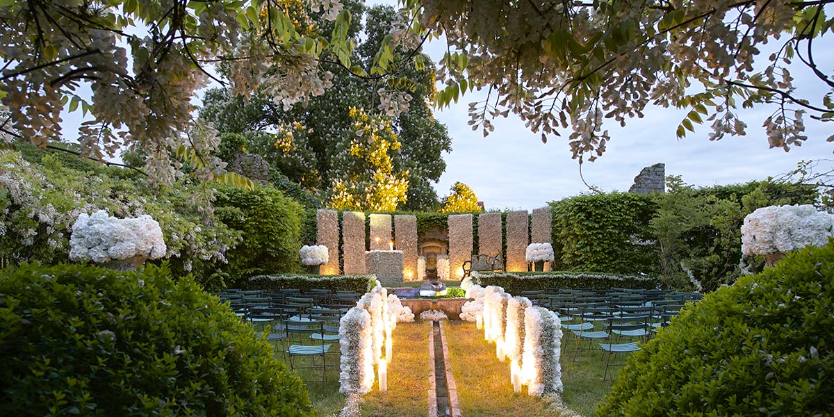 french chateau for wedding: rose garden flowery for ceremony
