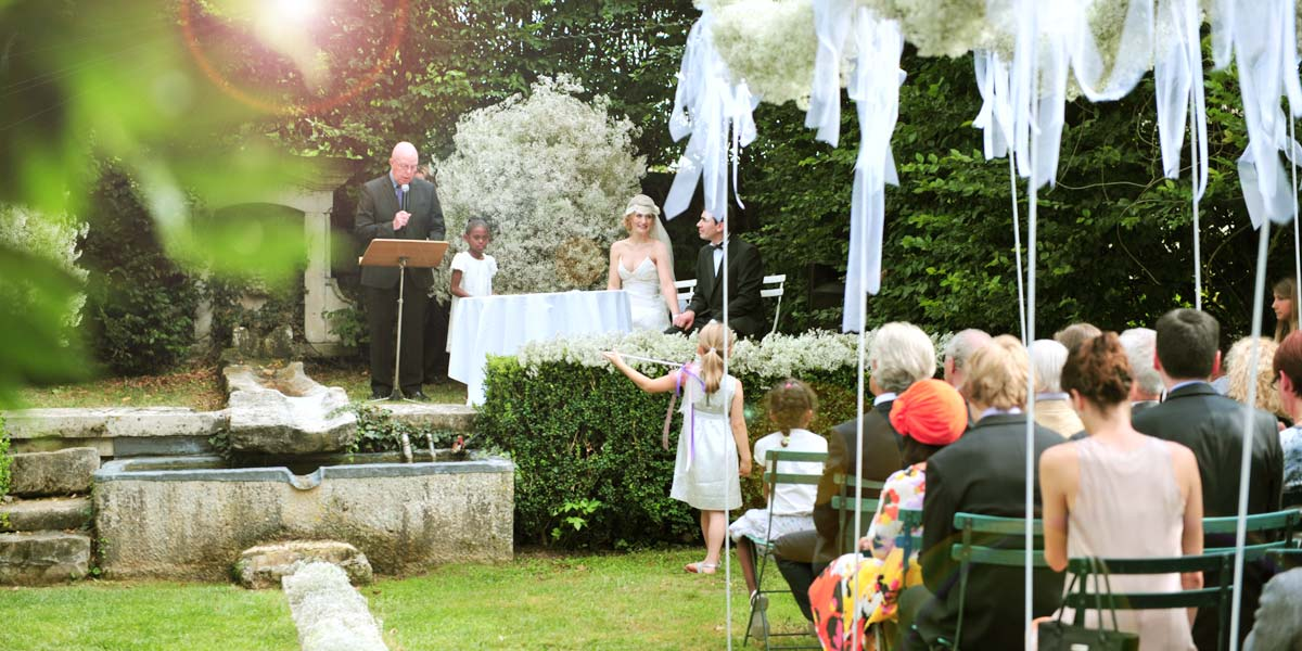 Pastor officiates protestant wedding in the rose garden