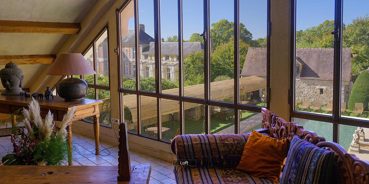 view of the chateau and pool from the Loft lounge