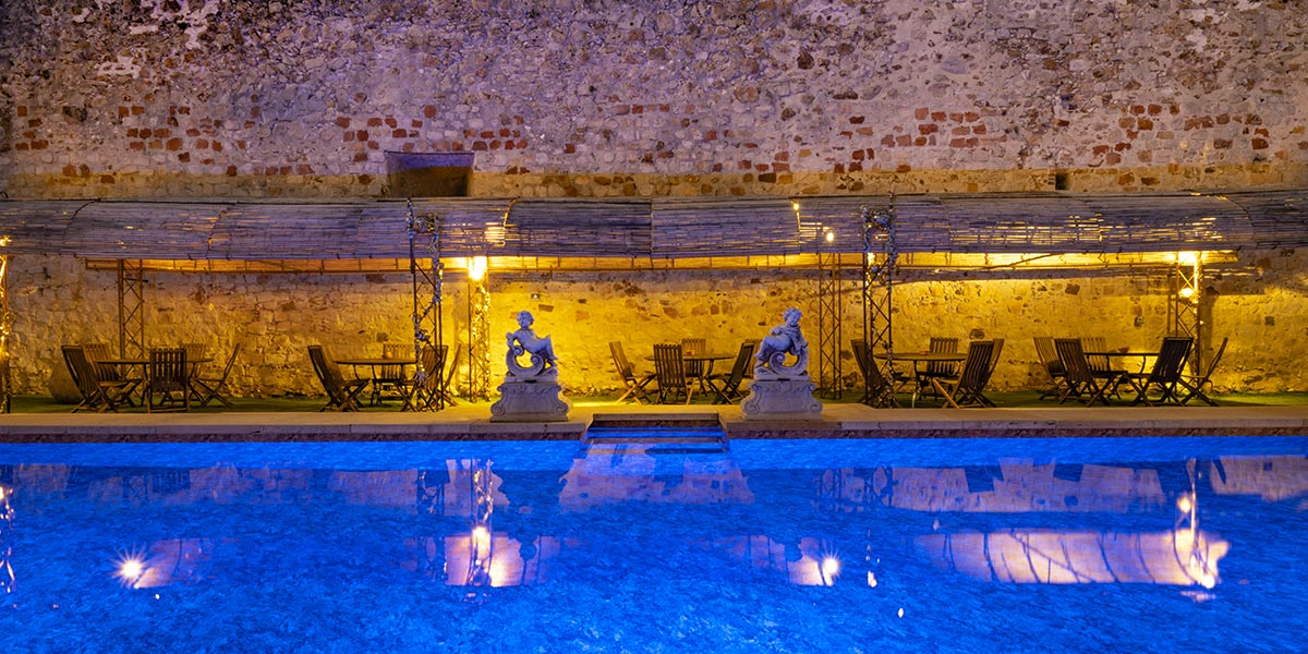 heated swimming pool against the ramparts